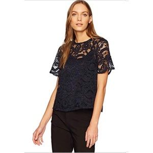 Black lace blouse with bow in the back